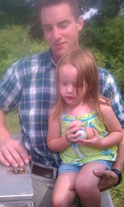Addi collecting eggs with Sam (farm owner)