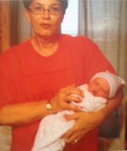 My mom holding Addi on the day she made me a mom.
